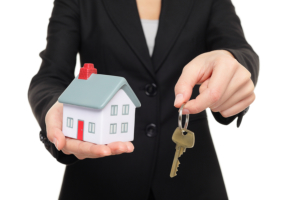 Real estate agent holding a key